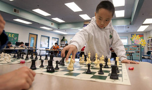TM 3rd-grader Roland Feng faces 16 players simultaneously in the Library in 2010.