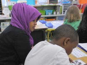 Tutor Ikram Abdullahi works with a student in April 2016.
