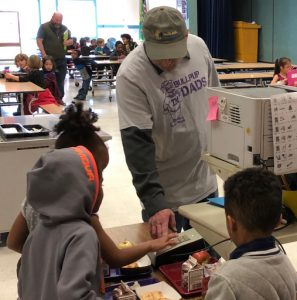 Photo of a Bullpup Dad helping in the Cafeteria